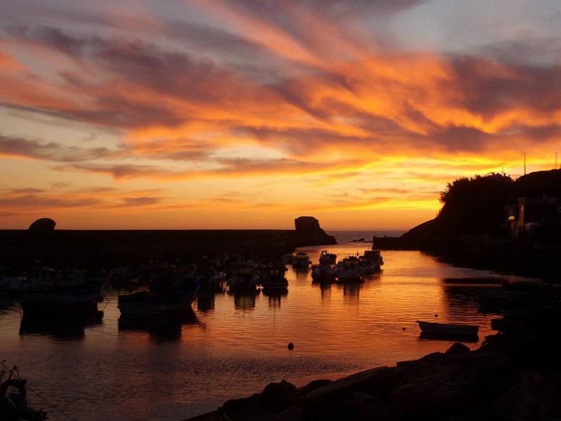 pôr-do-sol porto das barcas vila nova de milfontes